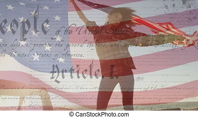 Animation of U.S. flag waving with U.S. Constitution text rolling over mixed race woman holding U.S. flag. United States of America flag and holiday concept digital composition