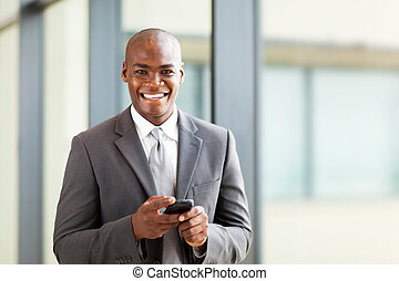 african business executive with smart phone