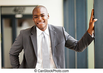 young african businessman in office