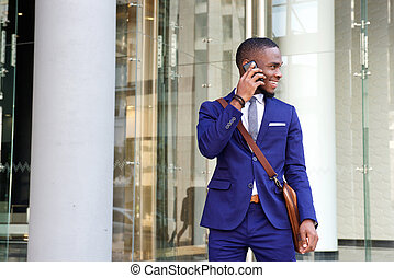 Young african businessman talking on mobile phone