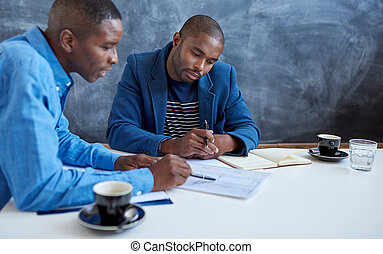 Young African businessmen working together in a modern office