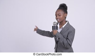 Young African businesswoman as newscaster presenting something
