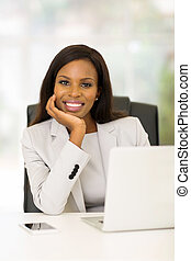 young african businesswoman relaxing in office