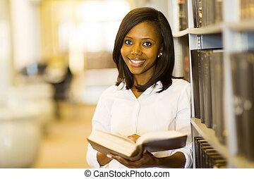 young african college student in library