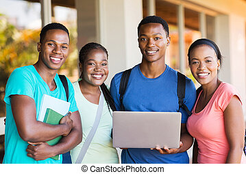 young african college students with laptop computer
