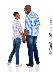 young african couple holding hands and looking back