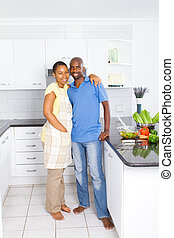 young african couple in kitchen
