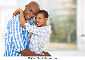 young african couple looking at the camera