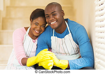 young african couple relaxing after housework
