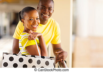 young african couple with shopping bag - beautiful young...