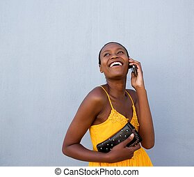 Young african lady talking on cellphone