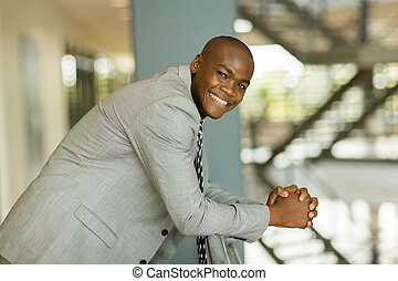 young african male corporate worker in office