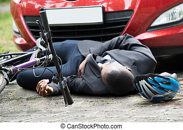 Cyclist Lying On Street After Accident