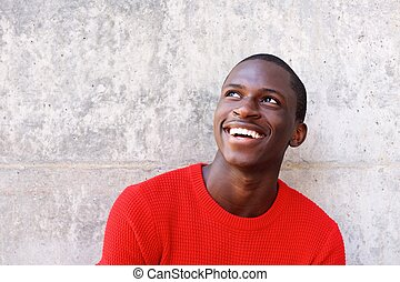 Young african man looking away and smiling