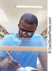 young african man studying in library