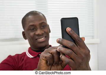 Young African Man Taking Selfie From Cellphone