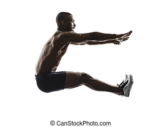 young african muscular build long jumping   man silhouette