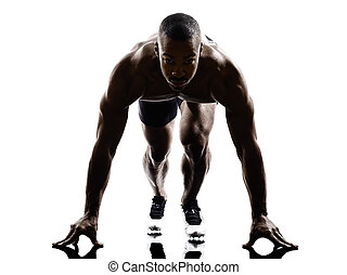 young african muscular build man on starting blocks...