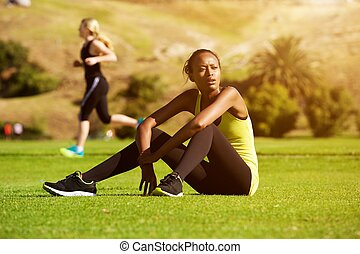 Young african sports woman relaxing after workout