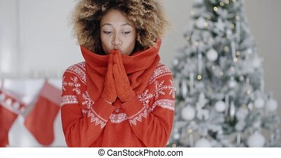 Young African woman celebrating Christmas