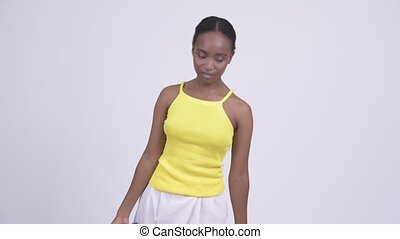 Young African woman exercising with dumbbells