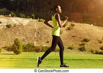 Young african woman jogging outdoors