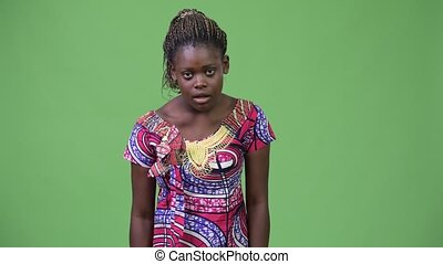 Young African woman looking excited