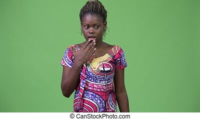 Young African woman looking guilty - Studio shot of young...