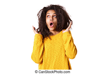 Young african woman looking surprised