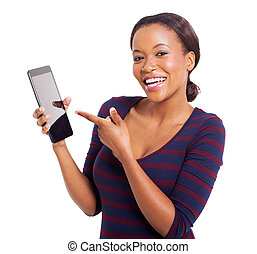 young african woman pointing at tablet computer