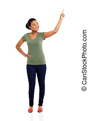 young african woman pointing up - beautiful young african...
