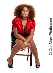 young african woman posed on chair