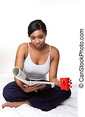 Young african woman Reading Newspaper on Isolated White...