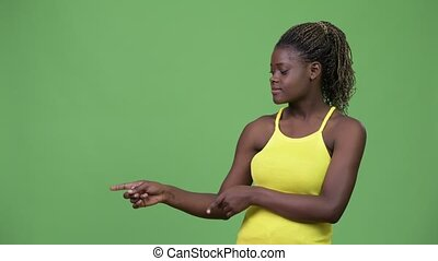 Young African woman showing something