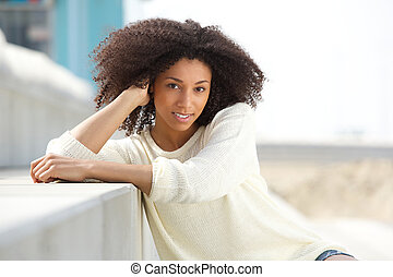 Young african woman smiling outdoors