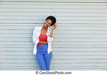 Young african woman smiling with hand in hair