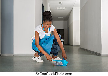Woman Sweeping Floor With Whisk Broom - Young African Woman...