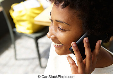 Young african woman talking on mobile phone