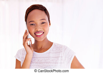young african woman talking on smart phone