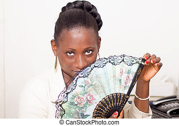 young african woman to her office