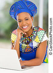 young african woman using laptop