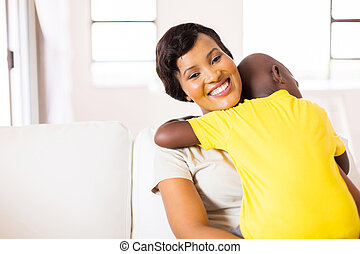 young african woman with her son at home