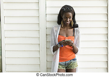 Young african woman with mobile phone