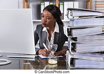 Young African Woman Working On Computer In Office