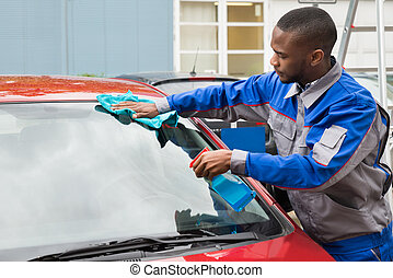 Worker Wiping Car Windshield