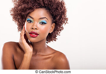 young afro american female model wearing colorful makeup