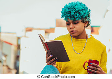 young afro american girl with book outdoors