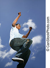 young Afro-American guy jumping in the air