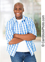 young afro american man with arms crossed