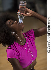 young afro american woman in gym have pilates workout break...